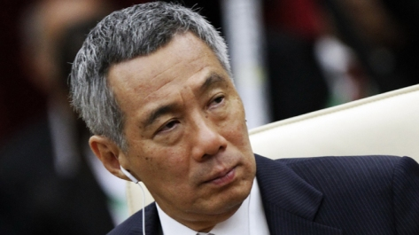 Singapore's PM Lee Hsien Loong attends a session of the 21st ASEAN and East Asia summits in Phnom Penh