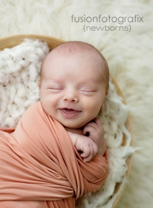 Winston-Salem-Newborn-Photographer-Smiling-baby-boy
