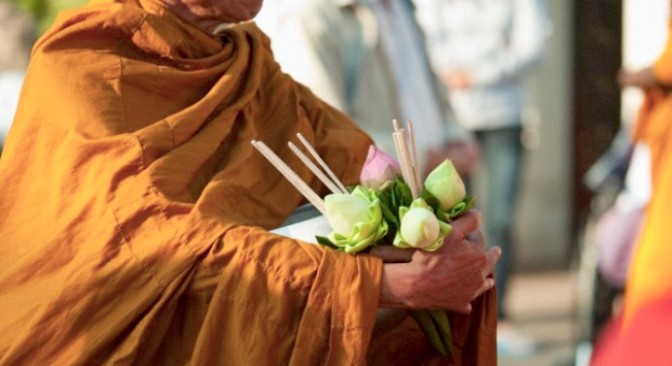 Thailand --- Thailand; A Buddhist Carrying Lotus Flowers And Incense --- Image by © Stuart Corlett/*/Design Pics/Corbis