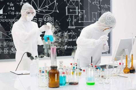 http://www.dreamstime.com/royalty-free-stock-photos-people-working-chemistry-lab-close-up-two-scientists-testing-laboratory-substances-table-colorful-liquids-image31257408