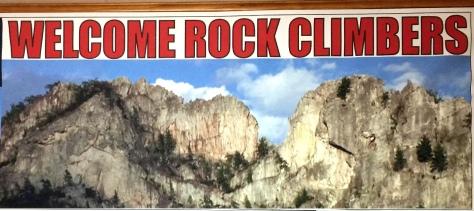Bảng chào mừng các rock climbers.