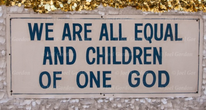 """Sikh quote """" We Are All Equal And Children of One God'  on side of float  before the start of the Sikh Day Parade in NYC."""