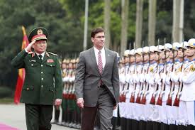 Kết quả hình ảnh cho U.S. Defense Secretary Mark Esper, center, and Vietnamese Defense Minister Ngo Xuan Lich review an honor guard in Hanoi, Vietnam, Nov. 20, 2019.